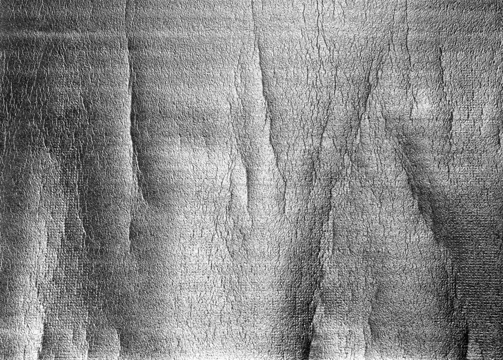 The surface of industrial material designed to cushion the flooring beneath us,   Underlay II   (2017) renders its machined banding visible across the image, giving way to what appears to be skin or bark.  Silver gelatin fiber print 30 x 40 inches