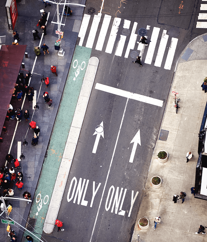 Overhead shot of a crosswalk next to the TKTS booth in Times Square.