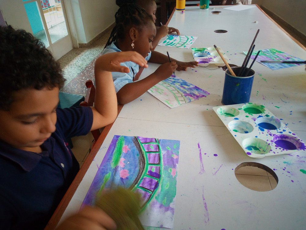 Crayon resist watercolor painting in 2nd grade Art class! We have a few Claude Monet's in the making!