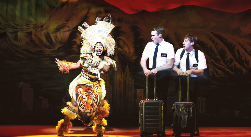 Phyre Hawkins, Ryan Bondy, and A.J. Holmes in The Book of Mormon.  ©  Jeff Busby.