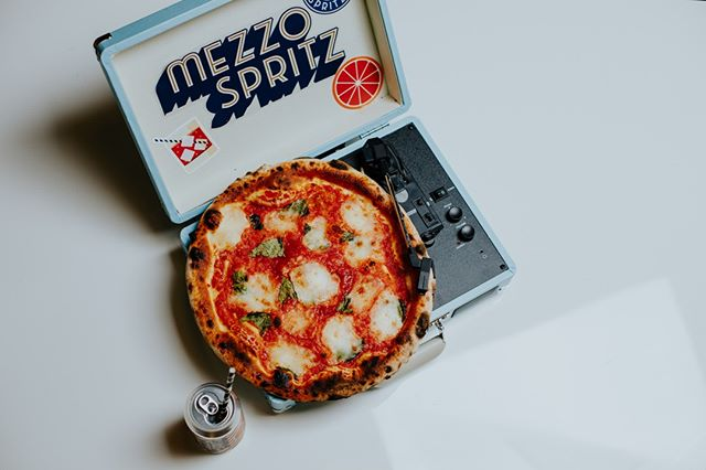 """Mezzo."" It's pronounced like ""pizza."" Mezzo is the Italian word for half, as in half the calories of an Aperol spritz. Look for Mezzo Spritz at your favorite bottle shop, and give it a spin. #nationalpizzaday"