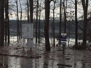 CJL sign in water after Dec rains