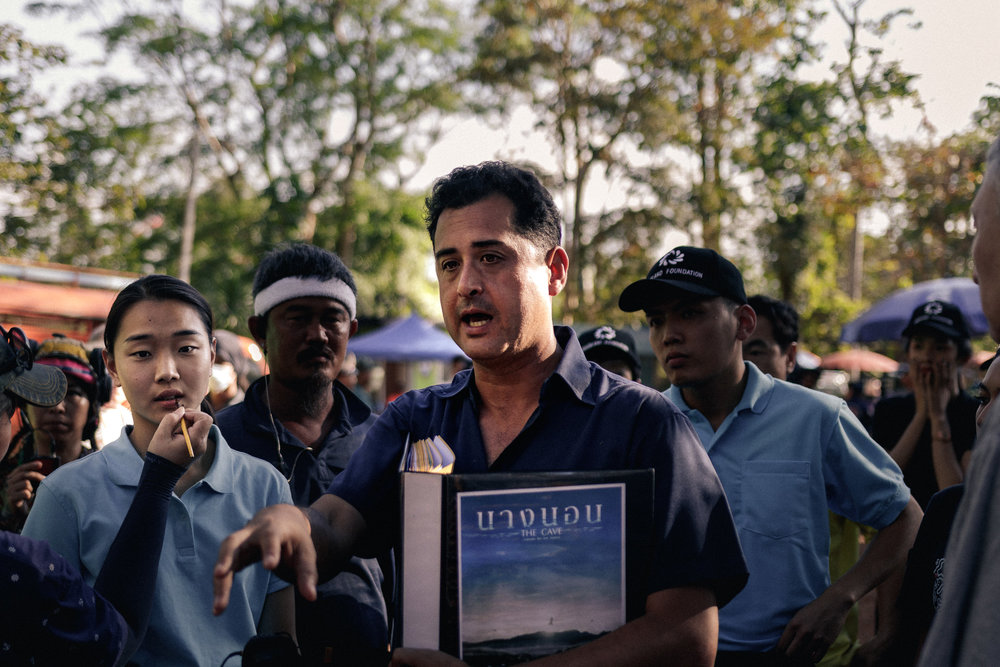 Writer/Director Tom Waller briefing actors on the set of 'THE CAVE' shooting on location in Thailand. Photo by Fredrik Divall (c) De Warrenne Pictures Co. Ltd. All Rights Reserved.