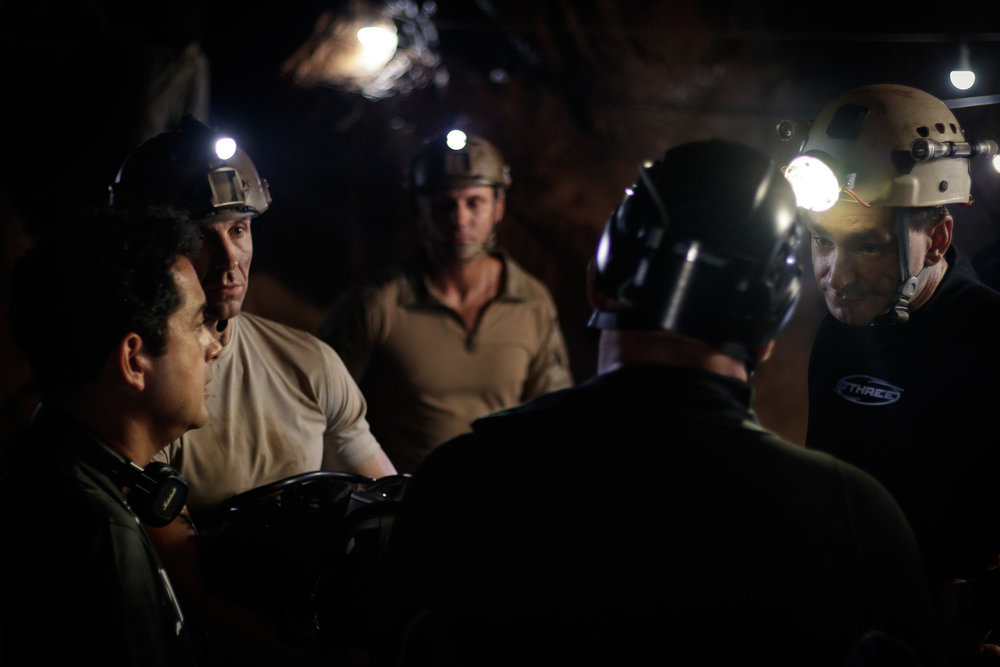 Writer/director Tom Waller briefs his cast on the set of 'THE CAVE' in Thailand. Photo by Fredrik Divall (c) De Warrenne Pictures Co. Ltd. All Rights Reserved.