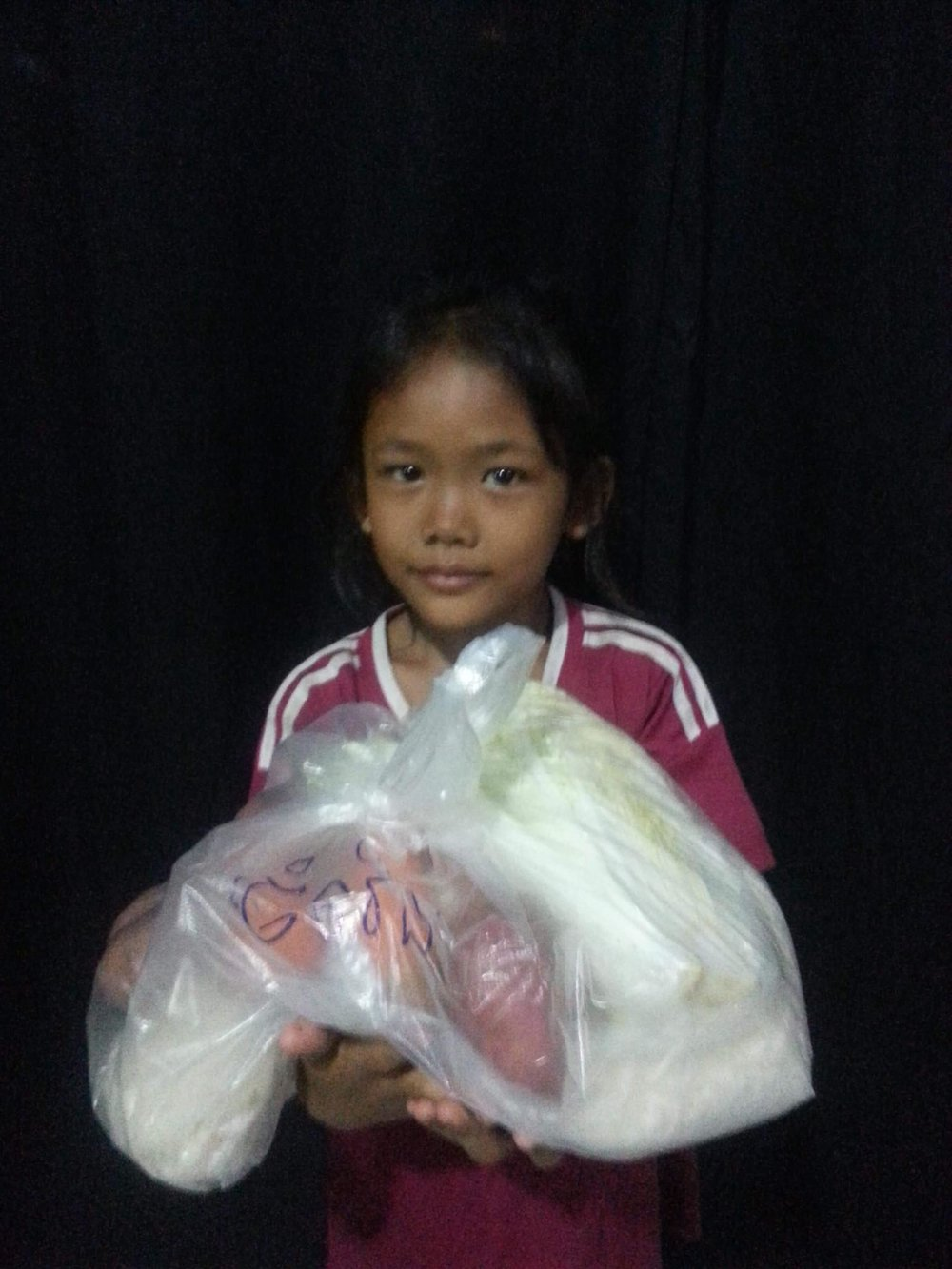 child recieving food for her family.jpg
