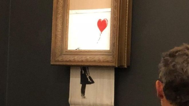Banksy Wasn't Critiquing Capitalism, He Was Taking Part In It - The street artist's prank at Sotheby's lit a trick candle in a musty room. But in rebelling against the monied art establishment, he still profits.