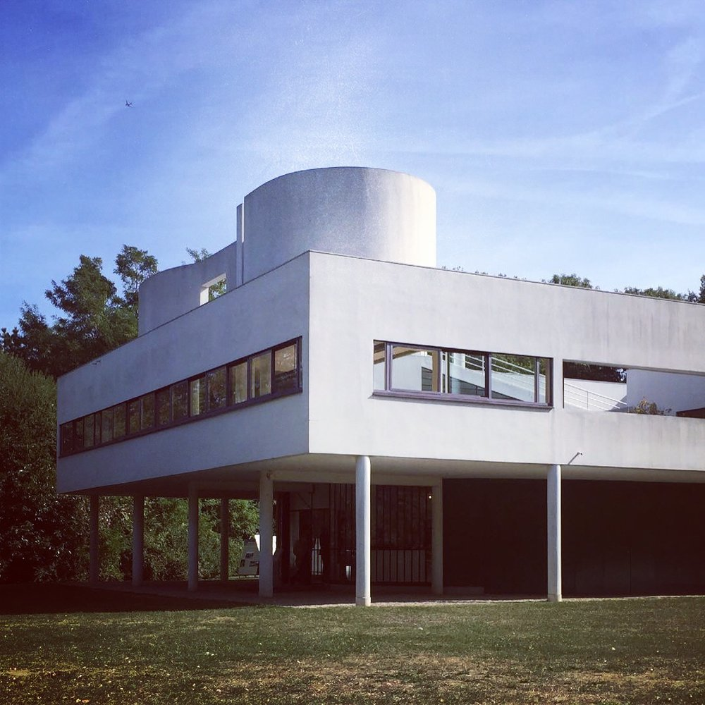 Villa Savoye, Poissy | Architecture, Relax - This is oh so worth the trip. Only 20 mins by the J train from Saint-Lazare lays a whole different world: you pay just 8 euros and then sunbathe on the grass or rooftop gardens and gaze at this architectural icon for, like, ever. The Le Corbusier building (1927- 31) in its white purist splendidness is an obvious cherry on the top, but its surroundings count, too: neighboring lycée, taking part of villa's original terrain and named after the architect, is a nice example of late 1950's modernist monumentality (1957 - 64, Eugene Chauliat), while some parts of this very old town take you to Burgundian Middle-Age village (e.g. the stunning Saint-Louis gothic church from the 14th century).