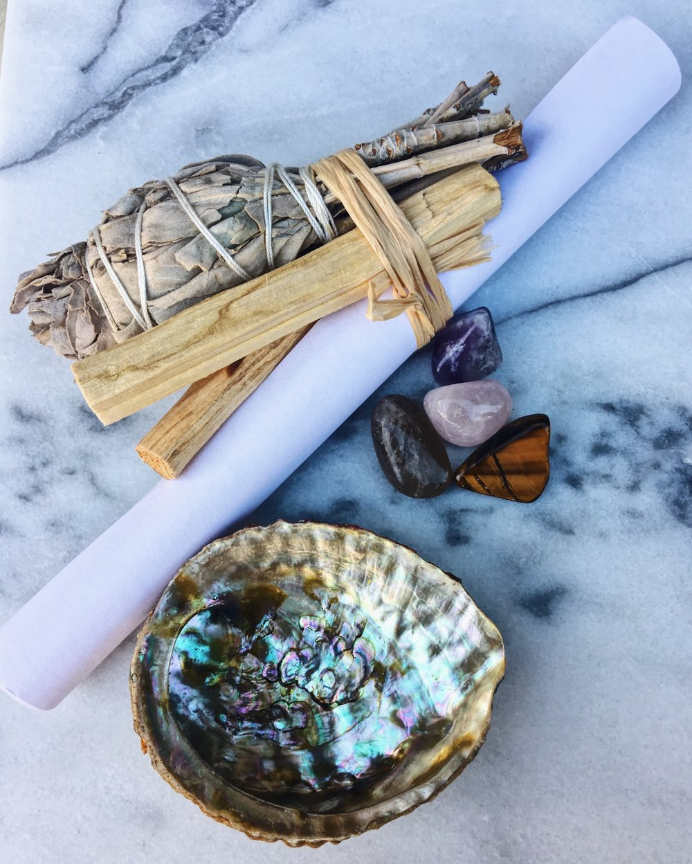 "small kit - This beautiful smaller kit contains white sage, palo santo, crystals, a 3-4"" abalone shell. All of the contents were activated and cleansed by at least 2 soundbaths using crystal bowls & smudged with sage.$25/kit"