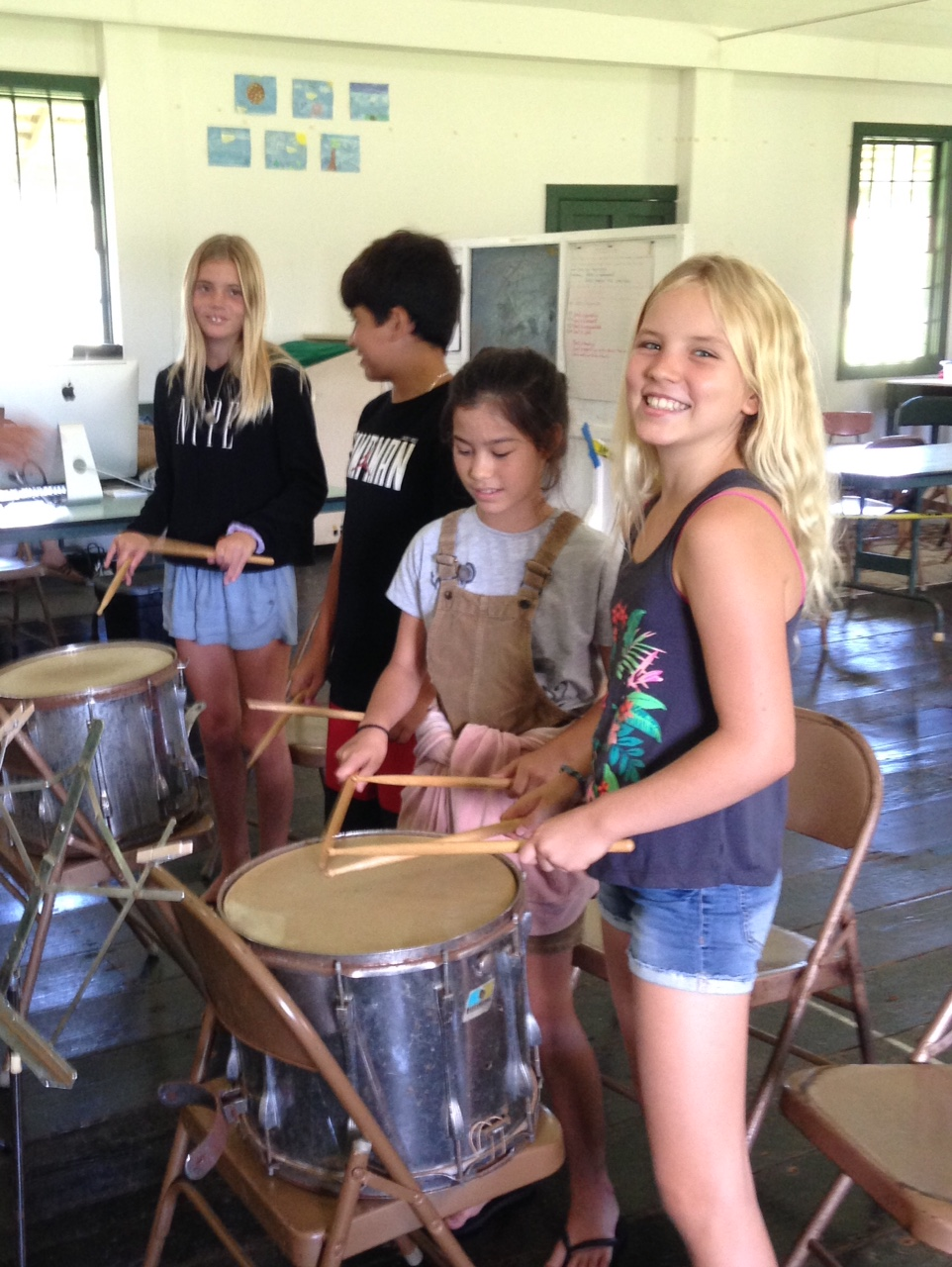 Music - Music at Hanalei School is a dynamic interactive music experience with an emphasis on singing, chanting, rhythm and movement. Songs from around the world are used to facilitate weekly explorations into various cultural songs, giving the Kindergarten through 4th grade an opportunity to notice similarities and differences to their own cultures and traditions.  Students are invited to explore their own creativity through movement, rhythm, chant, and song.  Hawaii State music standards, vocal and breathing techniques, steady beat, rhythm, percussion and ukulele are explored at age appropriate grade levels throughout the year.