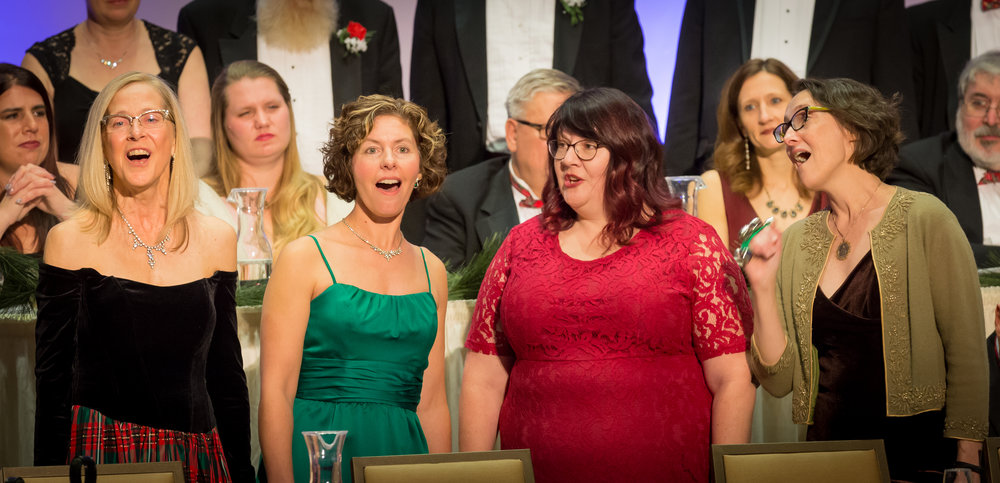 """The Ladies Must Sing quartet performing """"All I want for Christmas (is you)"""" at the 2018 Tudor Dinners"""