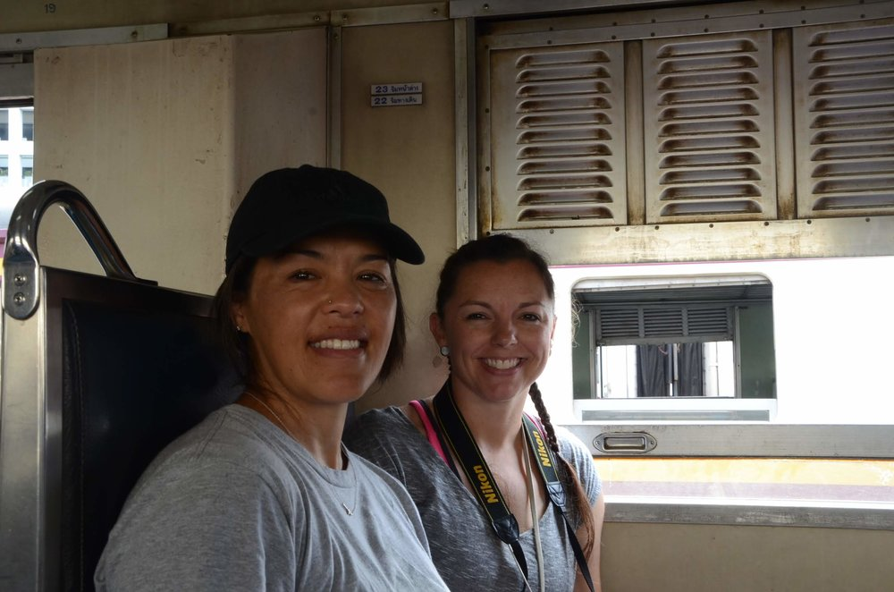 My travel buddy and I on the train. Notice the window is down to feel the breeze.