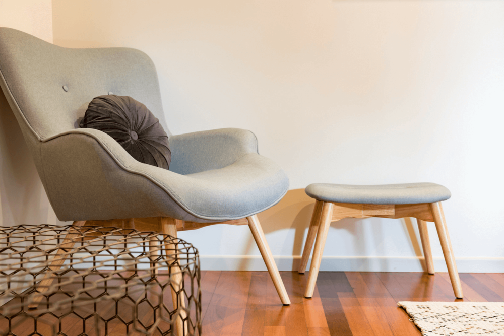 Curl up with a book in this day chair in the Opua apartment.