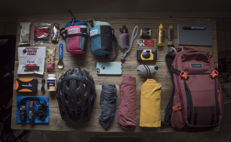 My table covered in essential gear at 11 pm on the eve of my first bikepacking trip.