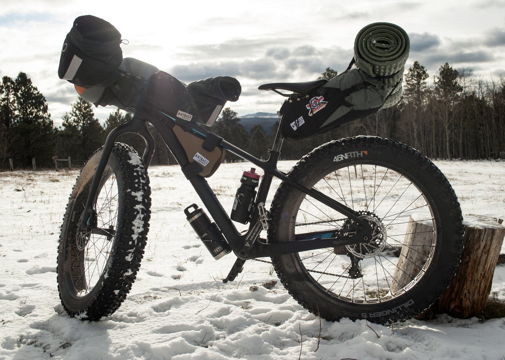 2018 Specialized FatBoy - Big Mama might be my favorite whip. She's outfitted with an Eagle drivetrain, a carbon fiber body, and burly studded tires. She's murdered out in all black, and when we get out into the backwoods we're completely hidden from the rest of the world.