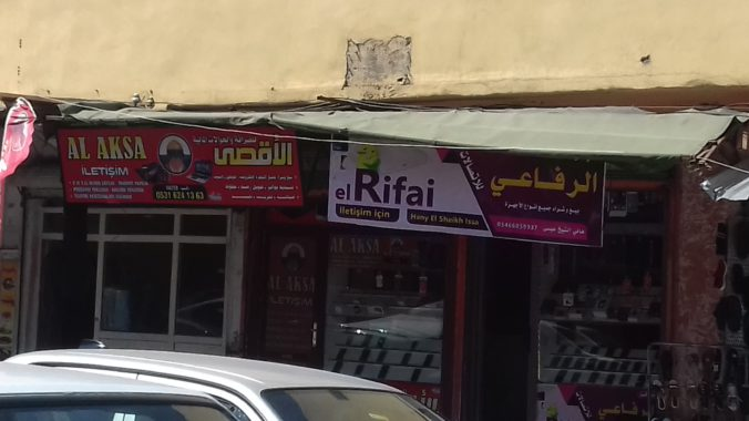 Two cell-phone store owned by Syrian refugees in a neighbourhood where Syrians live in high numbers at the city center of Şanlıurfa. Photo taken by the author on 28 August 2018.