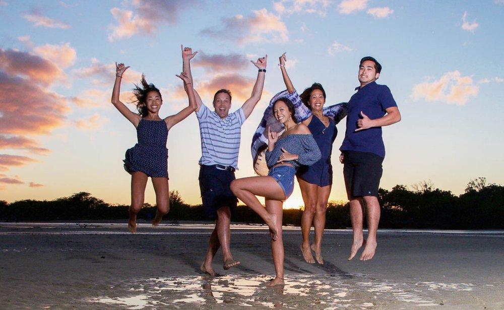 oahu hawaii sunset beach ocean family jumping photo portrait