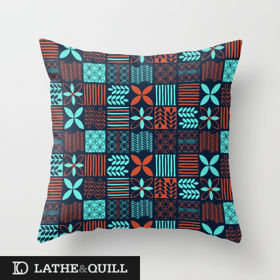 Pillow covered in modern tiki inspired repeat graphics