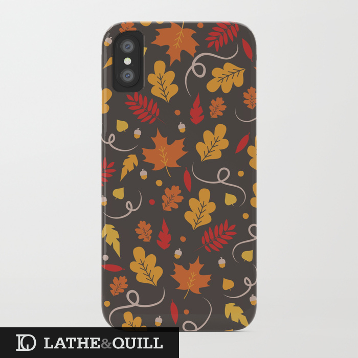 pattern of orange and yellow leaves on a dark grey background