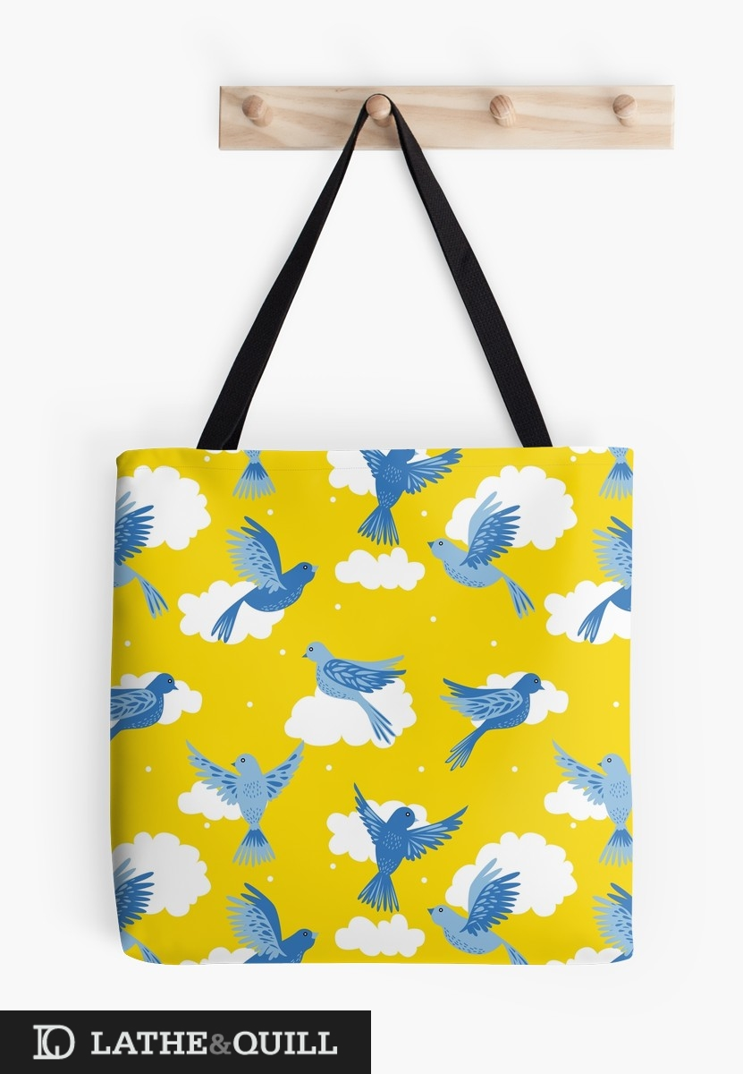 Tote Bag from Redbubble of blue bird on yellow sky with clouds