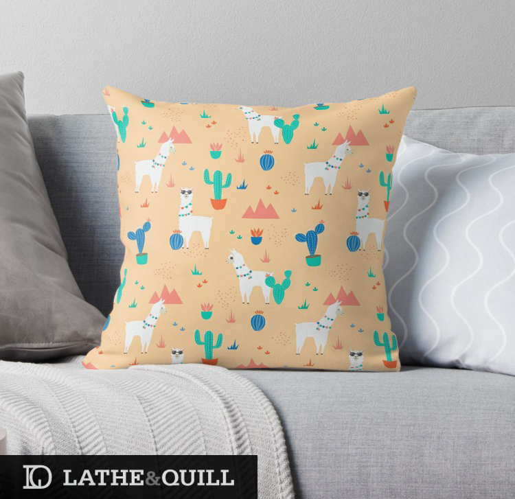 Pillow from Redbubble illustrated with llamas and cacti