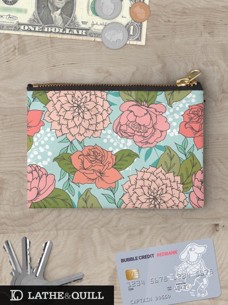 Floral pattern in spring colors in  a carry all pouch / clutch