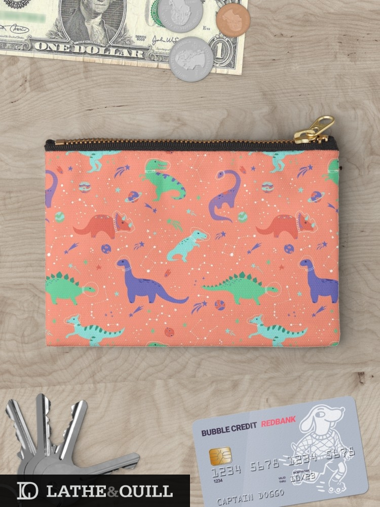 illustrated pattern of dinosaurs in girl themed colors