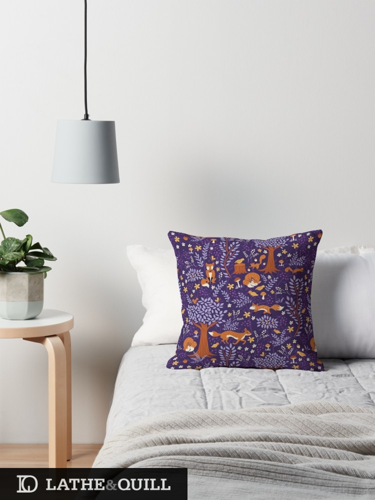 Pillow sitting on bed perfect for anyone who loves violet of foxes