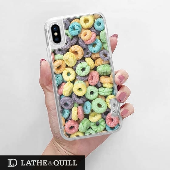 Photography of rainbow colored fruit ring cereal in clear casetify case