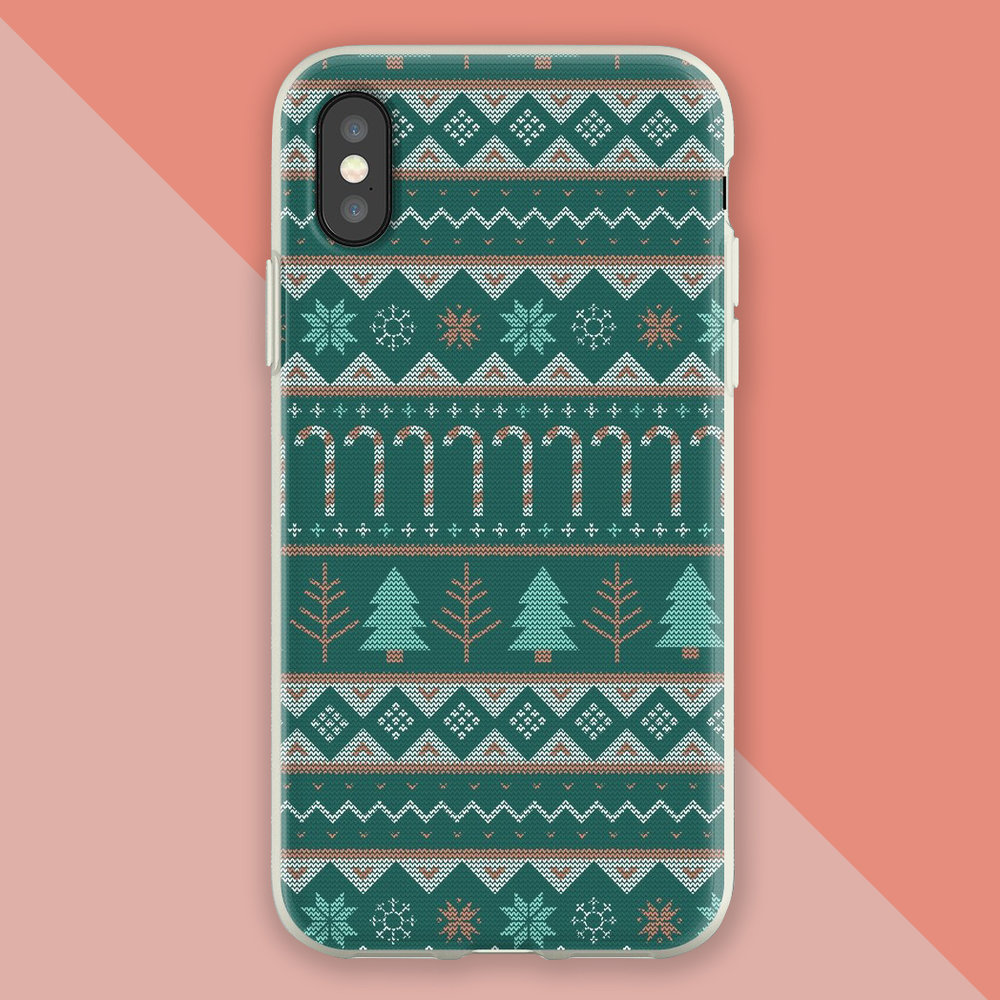 Christmas themed phone case with winter trees, snow flakes, candy canes in a linear fair isle knitting pattern