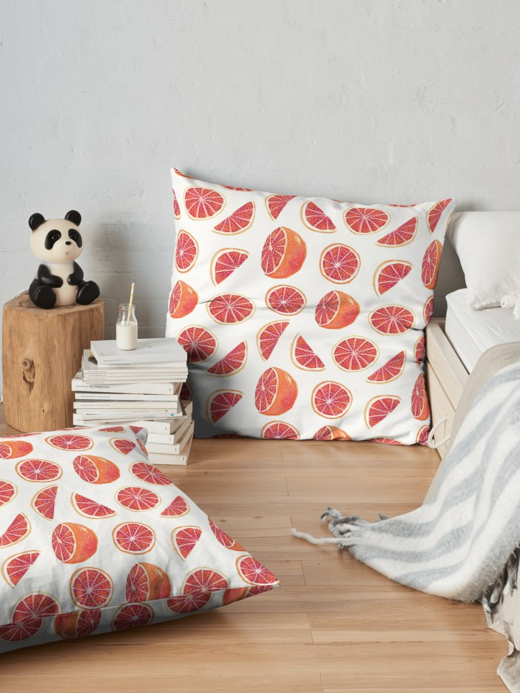 Vibrant red pulp in the orange flesh looks good enough to eat on these lounging pillows. love to cuddle with a book during January and February months