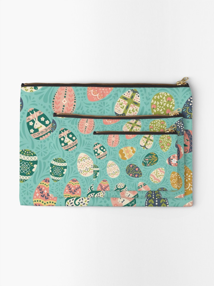 Bags available in 3 sizes from redbubble in aqua, gold, and coral with hints of spring and swirls