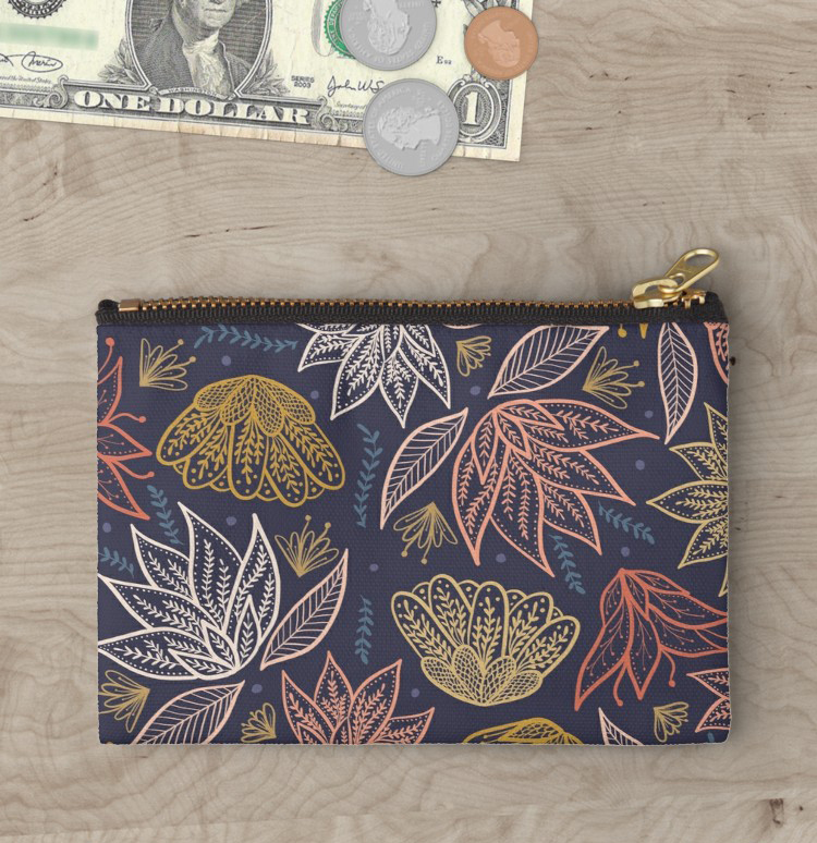 I always love a good clutch with a stylish pattern, these are a staple in my mommy essentials i keep things cute and functional