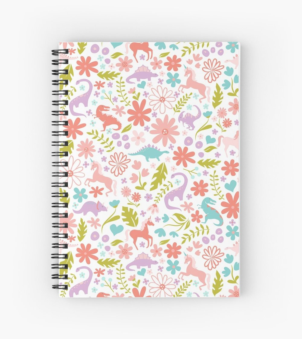 Spiral bound book with the flowers and brontosaurus, unicorns, t-rex, and diemetrodon,
