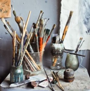 collection of painting tools on a table