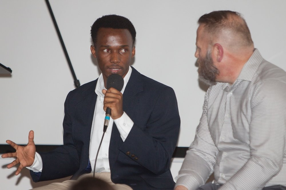 Ismail Ntakirutimana,    one of our Imana Kids, and Creighton student sharing his story with Pastor Chuck Kizer of Citylight Church