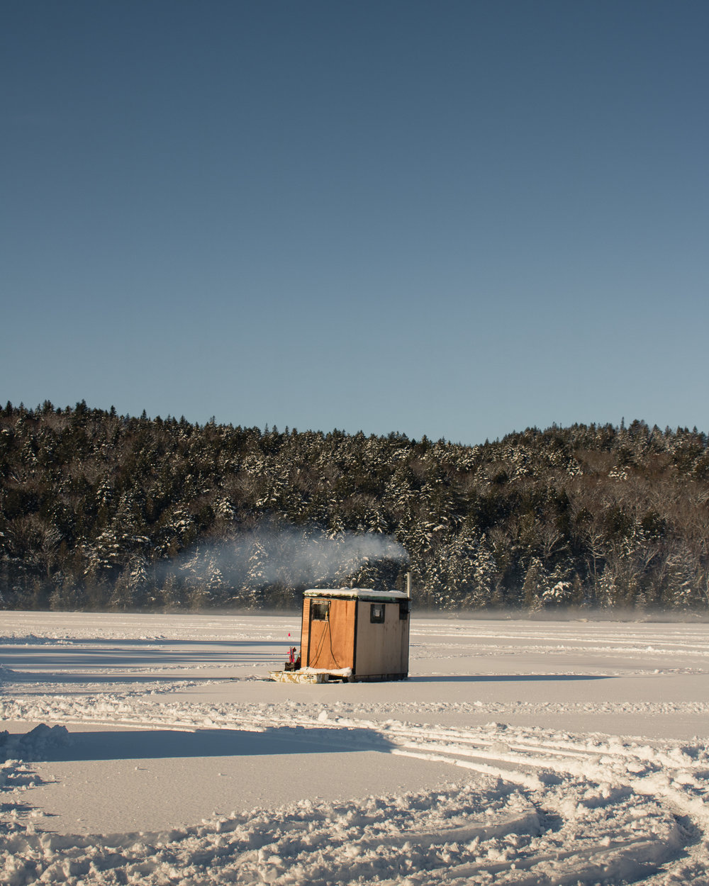 ice fishing hut on frozen lake