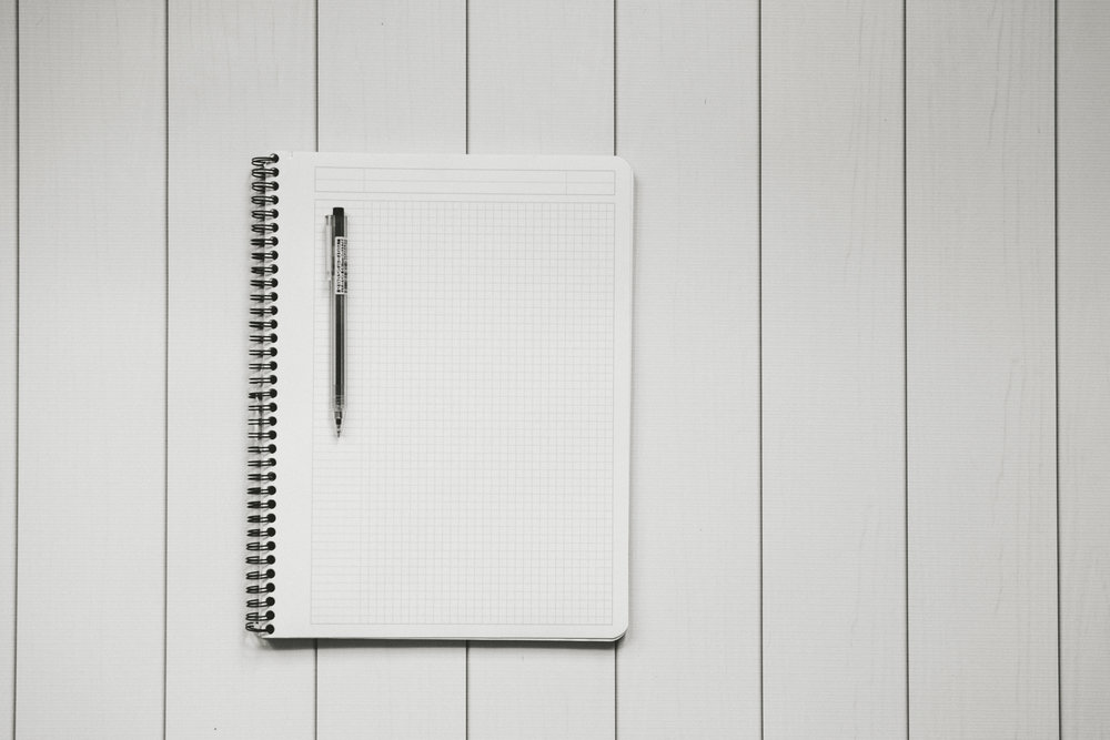 Image of a new notepad and pen