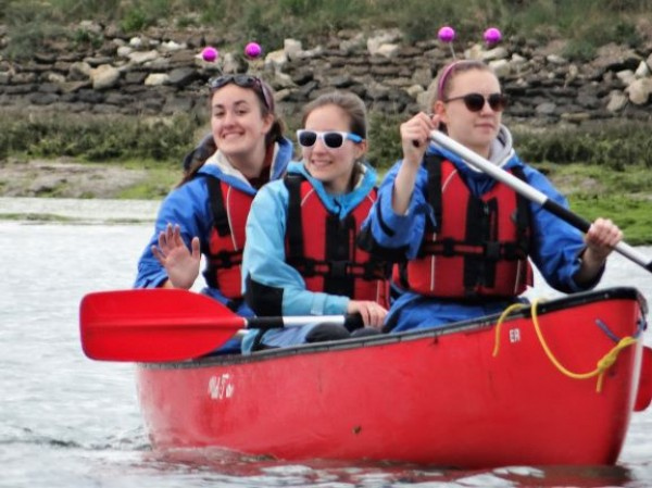 girls kayaking on revision christian holiday