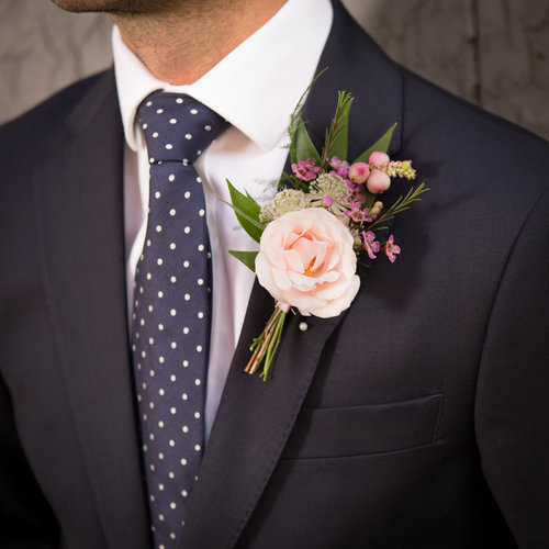 GROOM + GROOM - Our Groom + Groom package includes a minimum of two buttonholes and three footed urn table centres. Multiples of any item can be added at checkout. Just choose your colour palette and we'll do the rest.