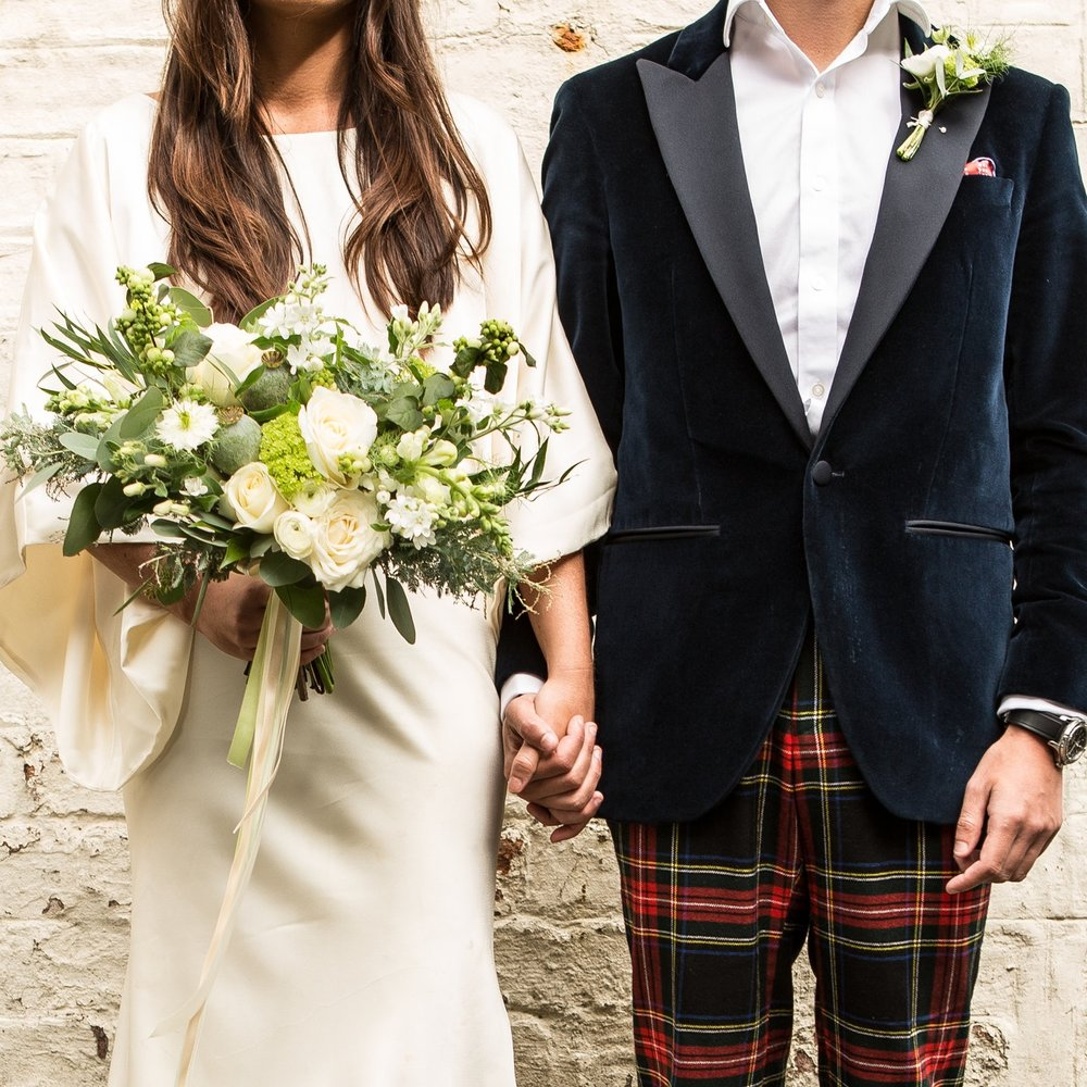 BRIDE + GROOM - Our Bride + Groom package includes a minimum of a bridal bouquet, a bridesmaid bouquet, a buttonhole and one footed urn table centre. Multiples of any item can be added at checkout. Choose your colour palette and we'll do the rest