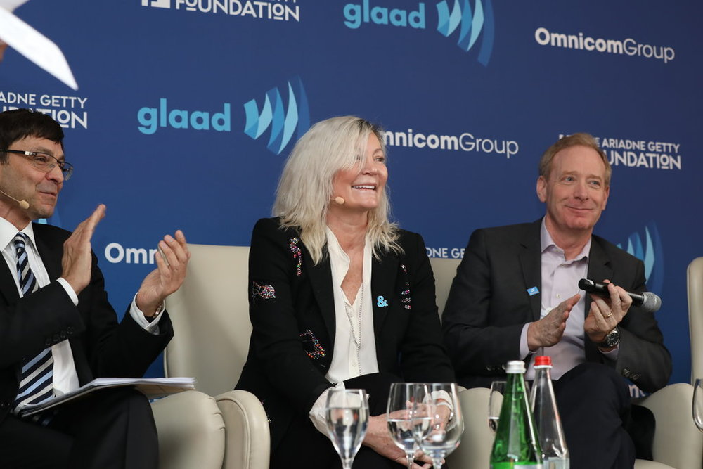 Ariadne Getty, center, speaks on a GLAAD panel at the World Economic Forum in Davos, Switzerland, alongside Serge Dumont, left, the vice chairman of Omnicom Group, and Brad Smith, the president and chief legal officer of Microsoft.    Tom Oswald/GLAAD