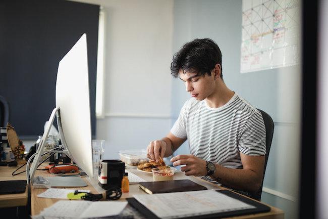 Man Eating at Desk.jpg