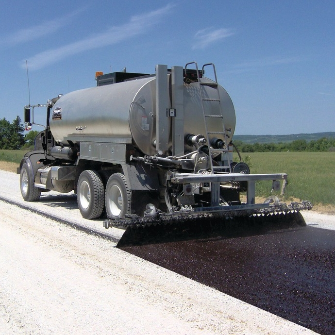 Asphalt Distributor - A truck or a trailer having an insulated tank, heating system and distribution system. The distributor applies asphalt to a surface at a uniform rate.