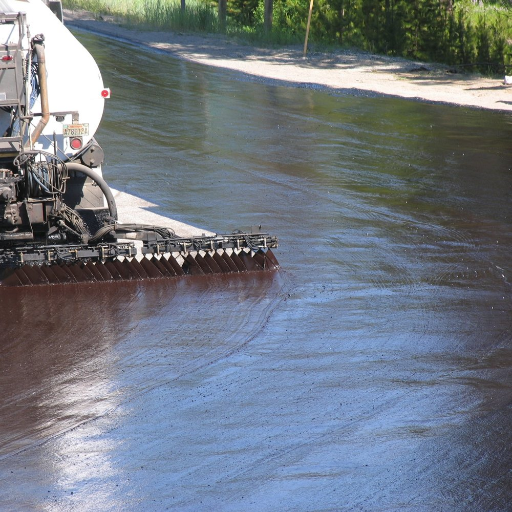 Asphalt Emulsion - An emulsion of asphalt binder and water that contains a small amount of an emulsifying agent. Emulsified asphalt droplets may be of either the anionic (negative charge), cationic (positive charge) or nonionic (neutral).