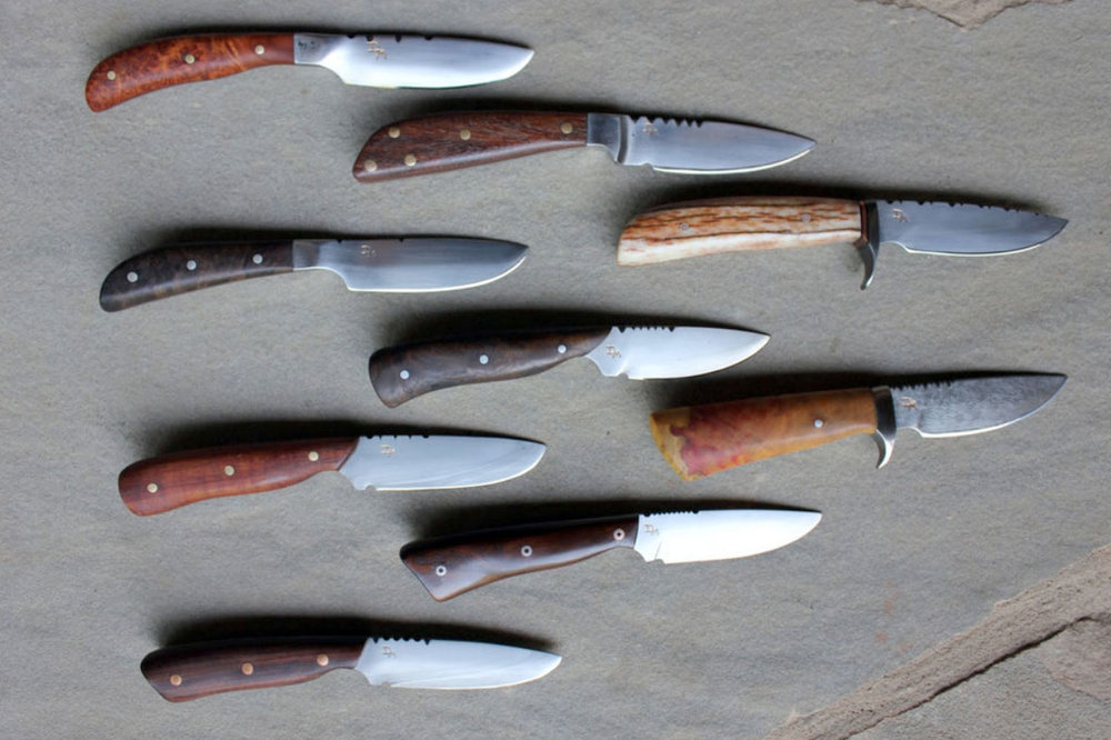 Custom Groomsmen Gifts:  Each groomsman's knife is unique