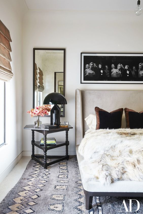 Perhaps one of our favorite rooms of the year is Kourtney Kardashian's guest room. It's effortless style. We applaud the mixture of textures: the woolly geometric rug, the fluffy fur throw, and the sleek table lamp. Source: Architectural Digest