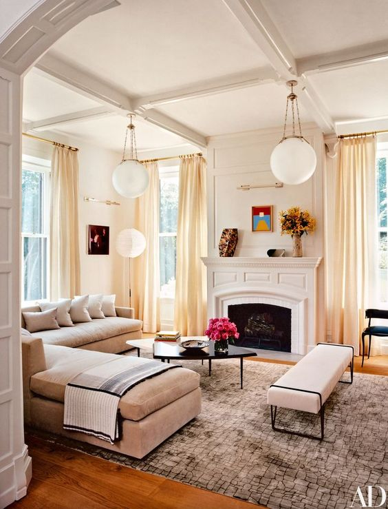 We're crazy for Sara Story's living room remodel. As the design pays homage to the home's Victorian frame through an elegant side chair and pendant lights, the room is also fresh and inviting with a snug sectional and buttercream drapery. Source: Architectural Digest