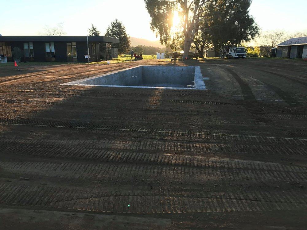 laser grading around pool 3.jpg