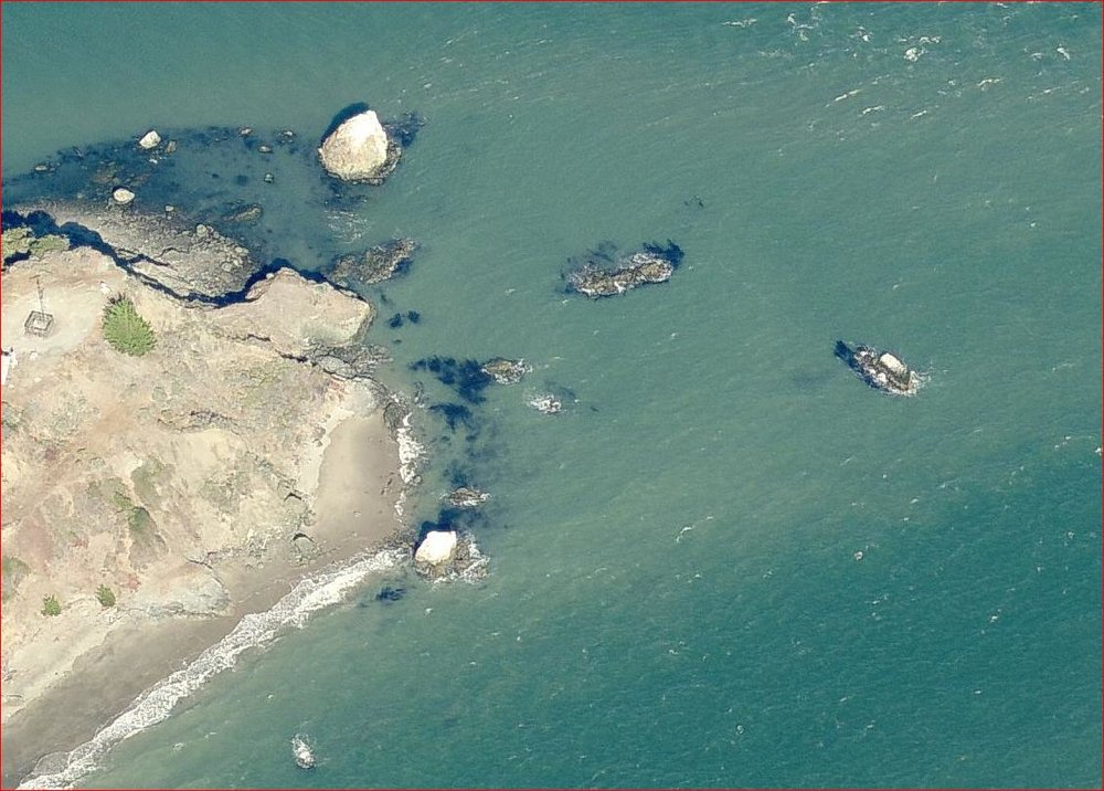 - An overhead view with west at the bottom and east at the top. The shoal is visible as a smudge. Note the ebb-induced roughness at the top. By slipping through the slot and curving around the tall rock you will avoid the tidal rip.