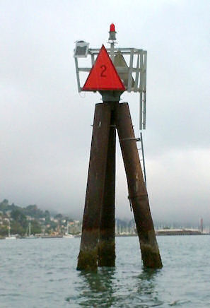 4. channel marker #2 - This tall group of three pilings is technically the outer marker of the Sausalito Channel, and also the point where the shallow bottom of Richardson Bay drops steeply into the central section of SF Bay. The mark is topped with an orange triangle symbol (with the number 2). Tidal currents beyond this point are stronger, so this is a good place for novices to turn back.